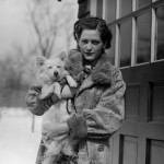 Norma with her dog,  Lady, after her arrest and before her jailing.  She is outside Rev. Brighton's home in Natick. Leslie Jones Collection, Boston Public Library.
